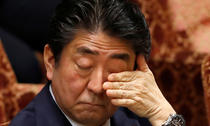Nearly half of Japanese think Abe should quit over land sale scandal: poll