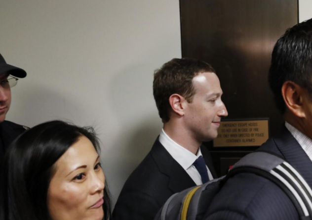Zuckerberg ditches T-shirt, apologizes for Facebook mistakes