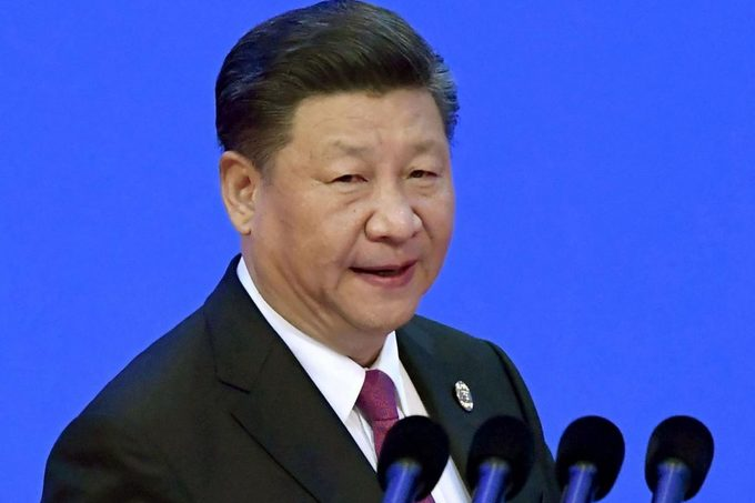 China's Xi renews pledges to open economy, cut tariffs this year