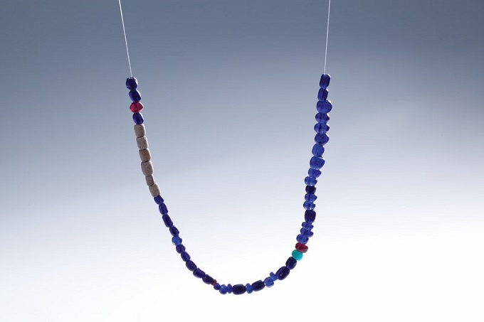 This glass necklace, found in Quang Ngai province in central Vietnam, belongs to the Sa Huynh culture (1000 BC to 200 AD). The period is well-known for sophisticated ornaments, which make use of jade and glass. File photos acquired by VnExpress