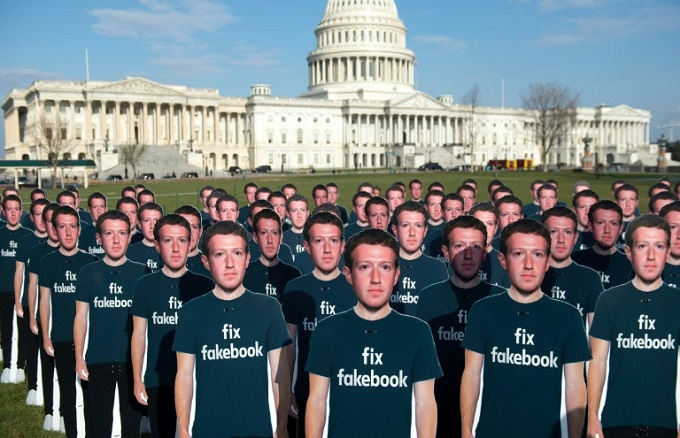 Cardboard cutouts of Facebook CEO Mark Zuckerberg stand outside the US Capitol, placed by advocacy group Avaaz to call attention to what the group says are fake accounts still spreading disinformation on Facebook. Photo by  AFP/Saul Loeb
