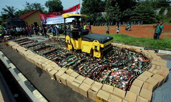 Indonesia steamrolls bootleg booze as death toll nears 100