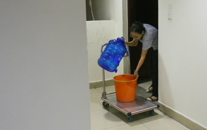 Thi, 60, uses this push cart to get clean water twice a day. The buildings investor gives each household here VND300,000 ($13) per day to hire a place outside but Ive got used to living here and so I dont want to move out.