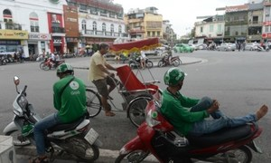 Vietnam opens investigation into Grab's acquisition of Uber