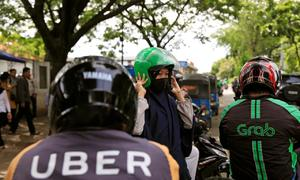 Vietnam's ex-Uber drivers shun Grab in favor of local competitors