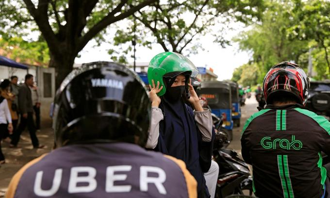 Vietnam's ex-Uber drivers shun Grab in favor of local competitors