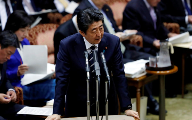 Japan PM Abe to sack top finance official accused of sexual harassment: paper
