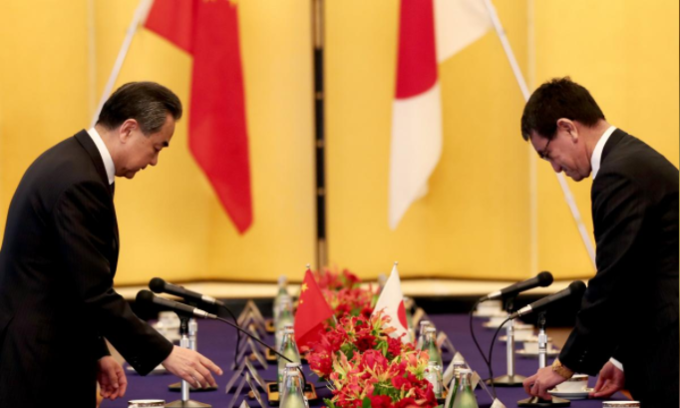 Japan, China pledge to work on economic ties amid heightened trade tensions