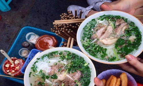 Making pho in Hanoi is an art, eating it is a logistical matter