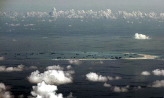 Philippines verifying photos of China military aircraft on reef