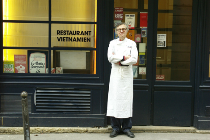 Robert Vifian stands in front of his Vietnamese restaurant in Paris in a photo supplied to VnExpress.