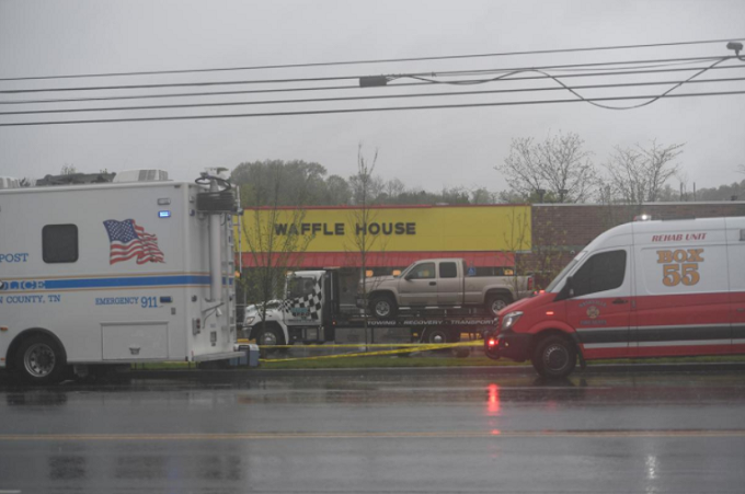 The truck of Travis Reinking, the suspected shooter, is loaded on a trailer ready to be towed from the scene of a fatal shooting at a Waffle House restaurant near Nashville, Tennessee, U.S. April 22, 2018. Photo by Reuters/Harrison McClary
