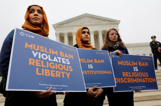 Protesters gather outside the U.S. Supreme Court in Washington, DC, U.S., April 25, 2018, while the court justices consider case regarding presidential powers as it weighs the legality of President Donald Trumps latest travel ban targeting people from Muslim-majority countries. Photo by Reuters/Yuri Gripas