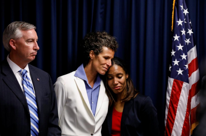 Bill Cosby accuser Andrea Constand embraces Special Prosecutor Kristen Gibbons Feden as Montgomery County District Attorney Kevin Steele looks on during a news conference after a jury convicted actor and comedian Bill Cosby for sexual assault during a retrial in Norristown, Pennsylvania, U.S., April 26, 2018. Photo by Reuters/Brendan McDermid