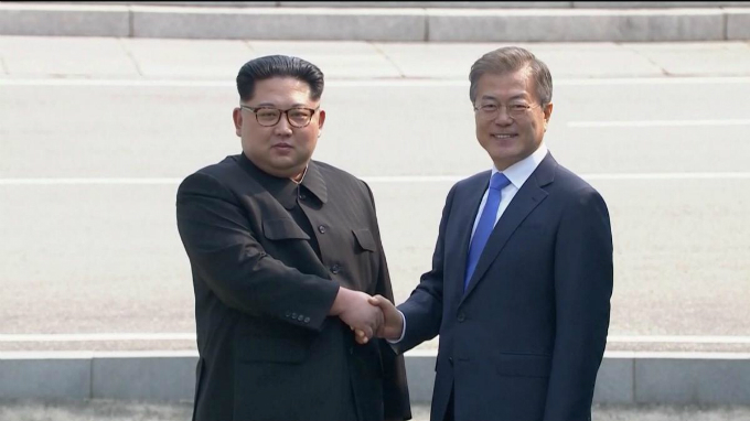 North Korean leader Kim Jong Un shakes hands with South Korean President Moon Jae-in as both of them arrive for the inter-Korean summit at the truce village of Panmunjom, in this still frame taken from video, South Korea, April 27, 2018. Host Broadcaster via Reuters TV