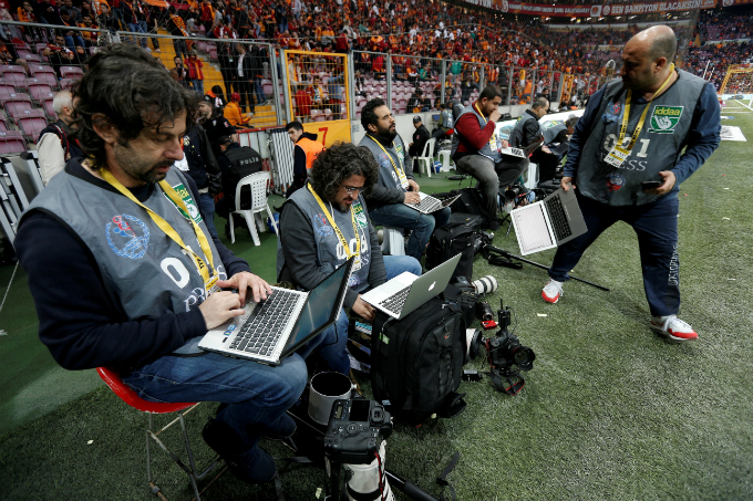 Photographers edit their pictures at half time during the Turkish Super League soccer match between Galatasaray and Besiktas at Turk Telekom Arena in Istanbul, Turkey April 29, 2018. Picture taken April 29, 2018. Photo by Reuters/Murad Sezer