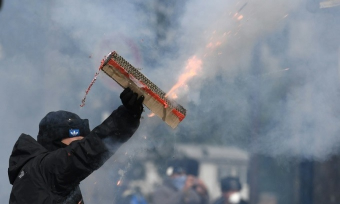 French government under fire after May Day chaos