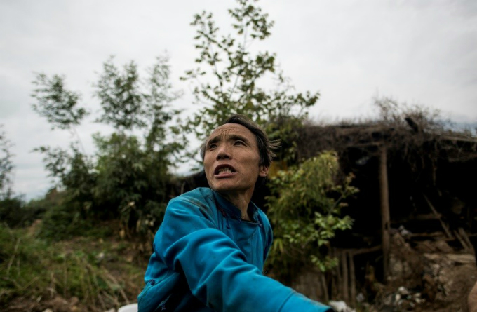 Wang Guocheng in the remains of his home in the old village of Luobozhai, which was damaged during the 2008 Sichuan earthquake, in Wenchuan county, Sichuan province. May 12, 2018 will mark the 10-year anniversary of the quake which killed some 87,000 people.