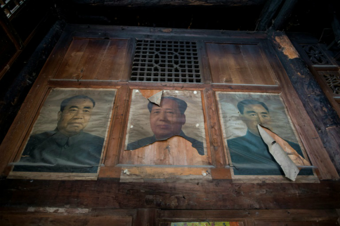 A poster of Mao Zedong (C) in a house damaged during the 2008 Sichuan earthquake.