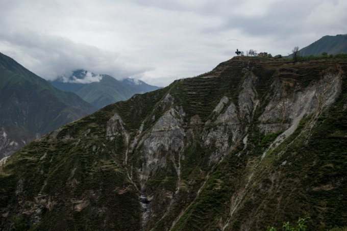 The mountainside surrounding the old village of Luobozhai was devastated in the earthquake. Most of Luobozhai moved to a new village nearby.