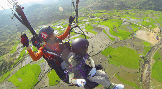 Up in the air: Paragliding over Vietnam's watery terraced rice fields