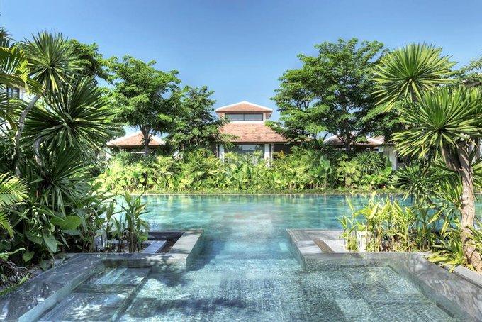 The swimming pool surrounded by green shade at Fusion Maia in Da Nang. Photo courtesy of Fusion Maia Da Nang