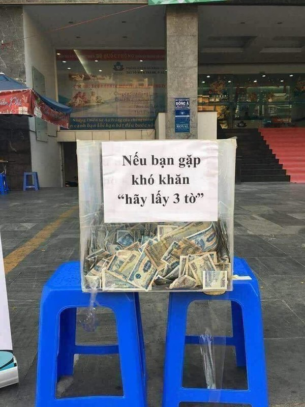 A photo shared on Facebook shows a box of change put on the street in Ho Chi Minh City to offer to people in need.