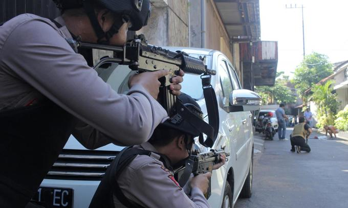 Militant family uses child in suicide bomb attack on Indonesian police