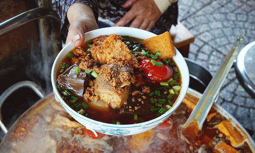 Inside Saigon's 30-year-old noodles shop, a tasty dance of tomato, crab paste and blood pudding