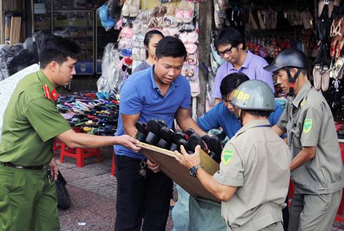 Saigon's sidewalk campaign resumes after months-long break