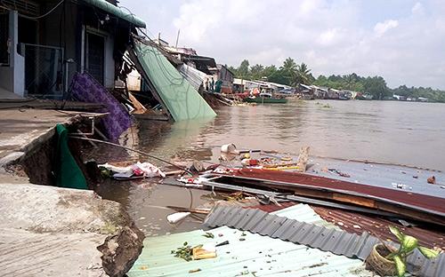 Erosion swallows five houses in Vietnam's Mekong Delta