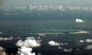 Beijing's South China Sea bombers fly in the face of protests