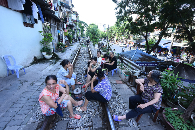 The trans-Vietnam train runs through a residential area in downtown Hanoi, lying just inches from houses.