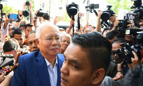 Malaysia's Najib quizzed over scandal, graft fighter reveals threats