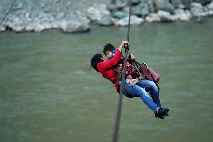 Just zipping out to the shops: mountain dwellers soar over angry rapids in China