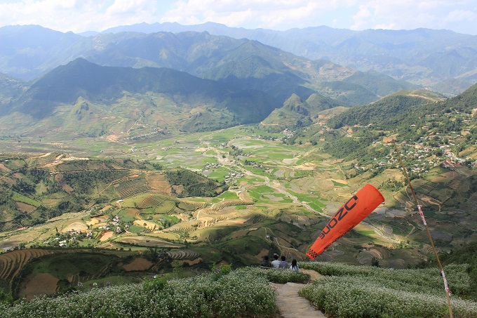 Watch paragliders spread wings above sun-kissed rice terraces in Vietnam