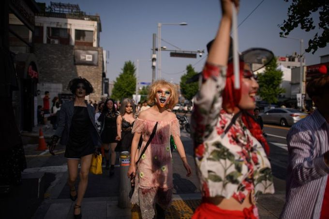 Dozens of drag queens and kings marched through Itaewon on Saturday, a suburb of Seoul best known for its nightlife and a nascent but vibrant gay scene. Photo by AFP
