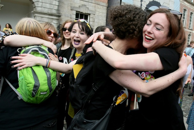 Yes campaigners celebrate the historic vote. Photo by AFP