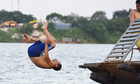 Hanoians turn giant river into free swimming pool for hot summer