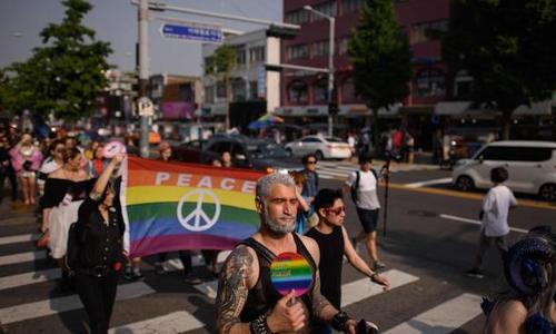 Rainbow flags and high heels: S. Korea holds debut drag parade