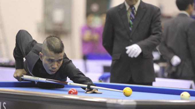 Take your cue from new Vietnamese world billiards champ