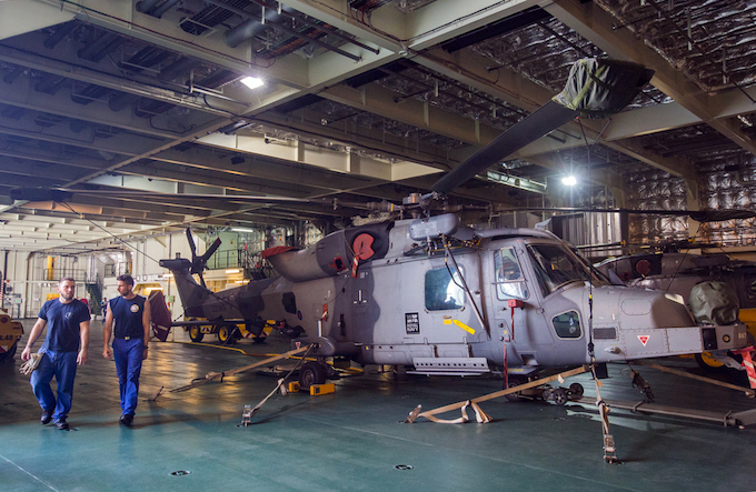 On the deck area are small maritime amphibious ships, fighter planes and drones. The two Wildcat helicopters  are capable of responding to anti-submarine and perform search and rescue.