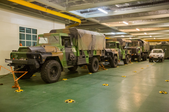Dozens of armored vehicles are arranged in the cabin.