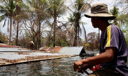 In rush to electrify, Cambodia stirs the living and dead