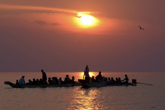Sunset views over Tonle Sap lake draw tourists and their money which helps offset a decline in the fish catch.
