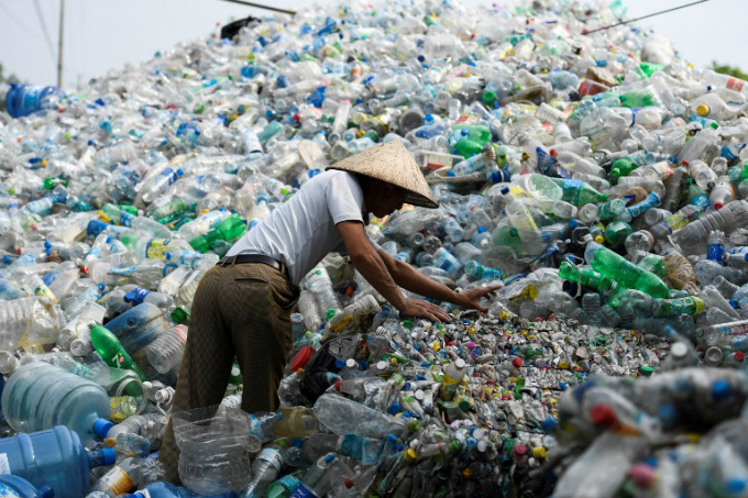 A Vietnamese man sorts through used plastic bottles at a junkyard in Hanoi on June 4, 2018. About eight million tons of plastic waste are dumped into the worlds oceans every year and over half come from five Asian countries: China, Indonesia, the Philippines, Thailand and Vietnam, according to a 2015 study in Science journal. Photo by AFP/Nhac Nguyen
