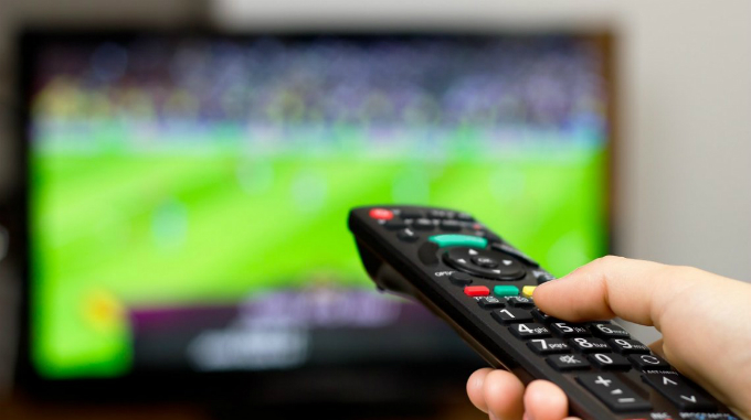 Remote reach: Many people and businesses have leased TVs and projectiors to watch and show World Cup matches. Photo: VnExpress