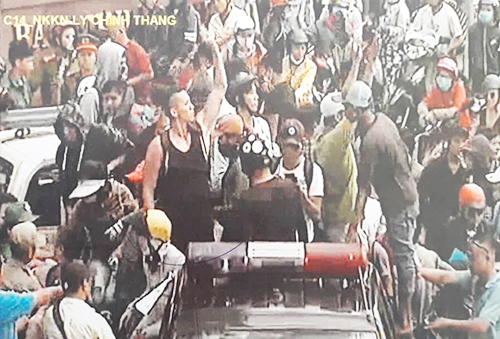 Screenshot from an online video shows Nguyen William Anh (in sleeveless T-shirt) at a protest in Saigon on June 10.