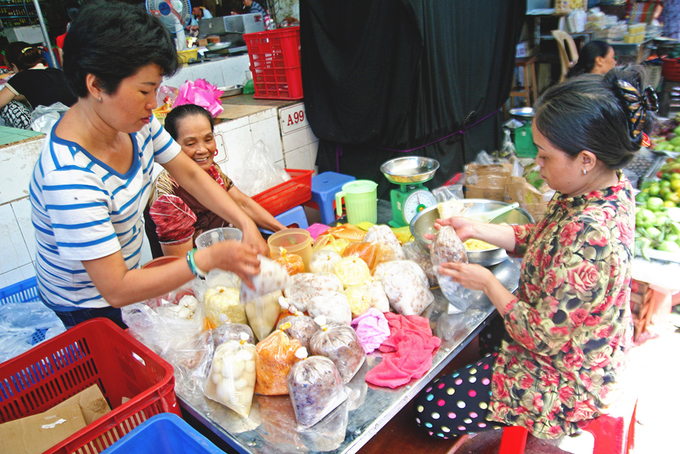 The market is bustling with new food products exclusively supplying for the cleansing festival.