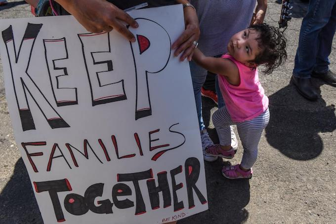 People participate in a protest against recent U.S. immigration policy of separating children from their families when they enter the U.S. as undocumented immigrants, in front of a Homeland Security facility in Elizabeth, NJ, U.S., June 17, 2018. Photo by Reuters/Staphanie Keith